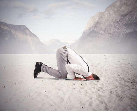 Concept of fear of the crisis with businessman like an ostrich photo