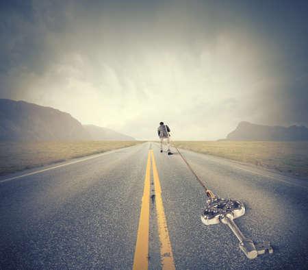 hard way: Concept of hard career with man pulls key to success