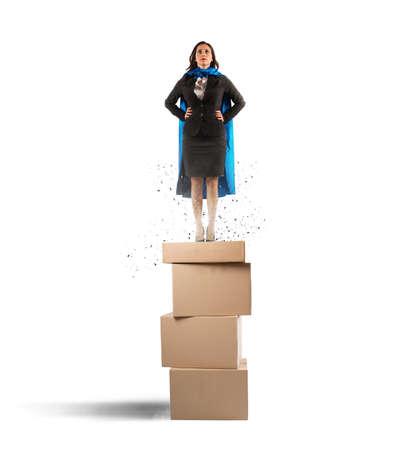 Concept of successful businesswoman like a super hero photo