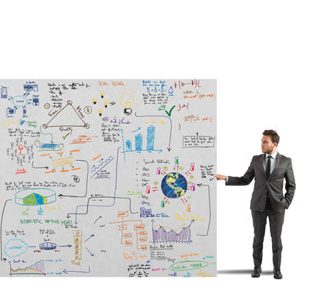 Businessman showing a sketch of a business project Stock Photo - 30143603