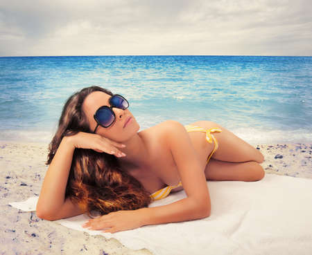 Concept of summer with girl relaxing at the beach photo