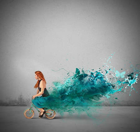 Concept of creative fashion with girl on bike photo
