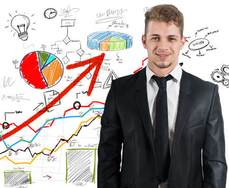 Successful businessman with business sketch of statistics photo
