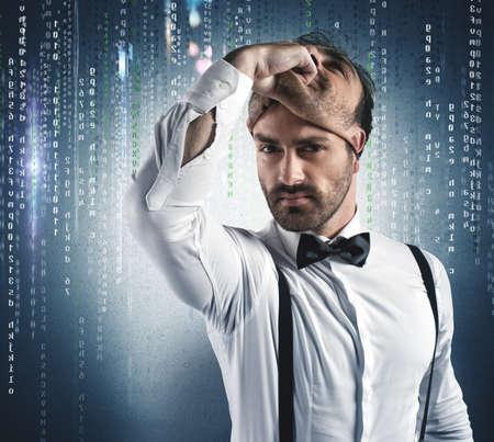 Hidden identity of a hacker under the mask Standard-Bild