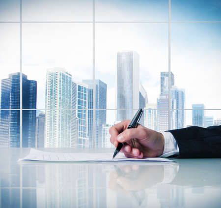 autograph: Man signing a business contract in a desk