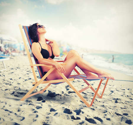 Concept of summe relax with beautiful girl under the sun photo