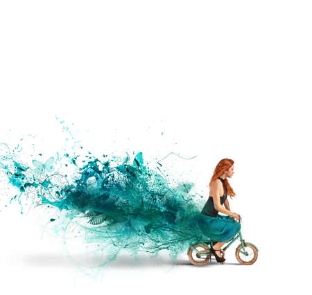 Concept of creative fashion with girl on bike Banco de Imagens