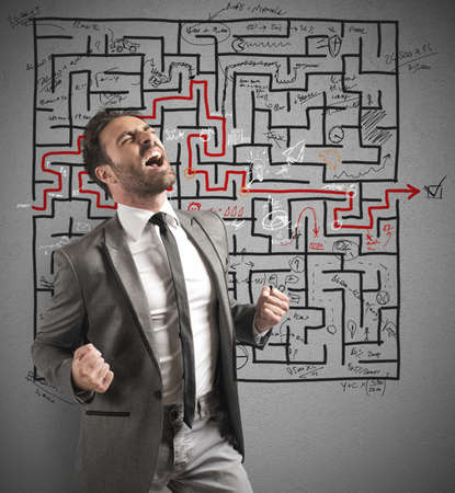 maze: Concept of successful businessman with solution of a maze