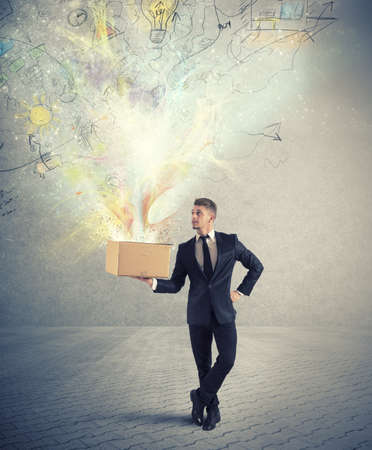 innovation: Businessman holding a creative business box Stock Photo