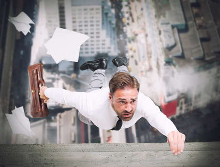 fear of failure: Businessman is going to fall from a skyscraper