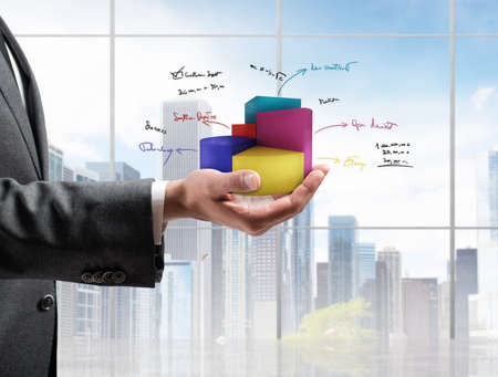 increment: Businessman shows successful statistics of a company Stock Photo