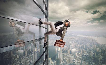 Determined man running up a skyscraper