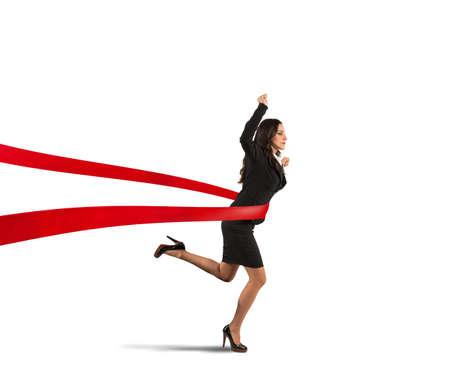kavram: Bir bitiş çizgisine kazanan businesswoman Kavramı Stok Fotoğraf