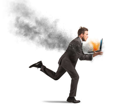 Concept of stress with running businessman with a burning laptop