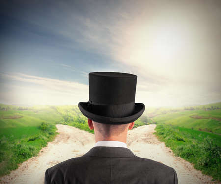 The right destination concept with businessman at crossroad photo