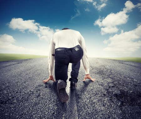 Gemotiveerde zakenman klaar om te beginnen naar succes Stockfoto