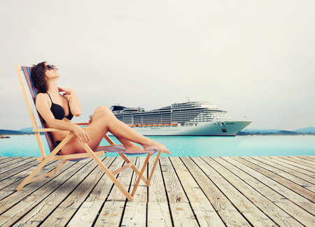 ships at sea: Girl relaxing on holiday with cruise ship