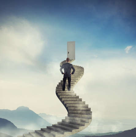 clouds and skies: Businessman ready to reach a new opportunity door Stock Photo