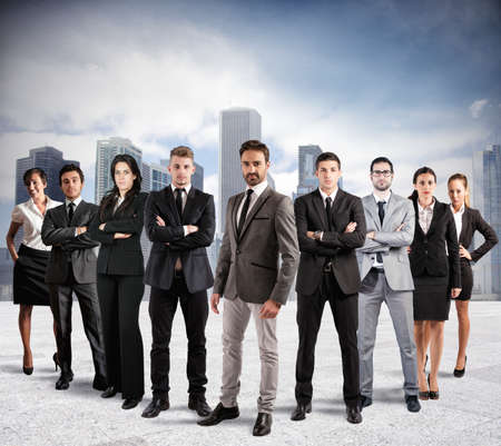 team success: Concept of teamwork and partnership with a group of businessperson Stock Photo