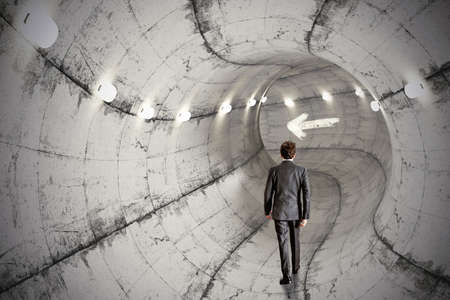 tunnel portals: Concept of business tunnel with walking businessman