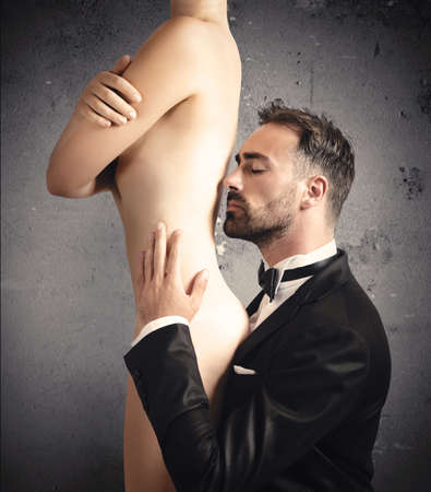 nude pose: Elegant man smelling a beautiful sexy girl