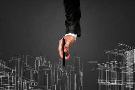 vision futuro: El hombre saca un proyecto futurista de un edificio
