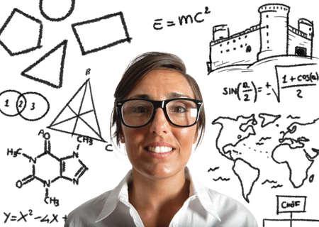 Genius teacher against a blackboard with draft photo