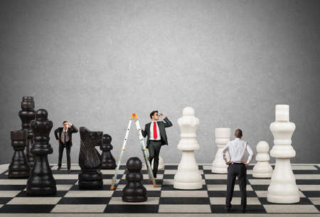 Strategy and tactics of a team of businessman Stockfoto