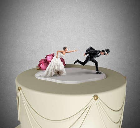 Funny Escape from marriage concept over a cake photo
