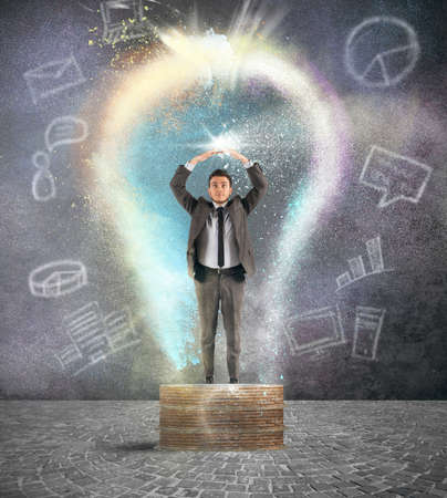 intelligent solutions: Concept of brilliant idea with businessman inside a lightbulb Stock Photo