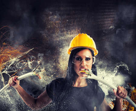 electrifying: Sexy rebel girl breaks big electrical cables Stock Photo
