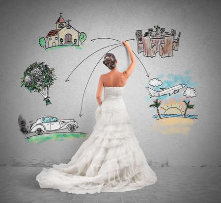 marriages: A woman arranges her marriage with a draft project Stock Photo
