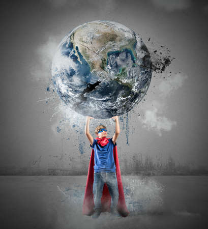 super powers: Little superhero saves the world.  Stock Photo