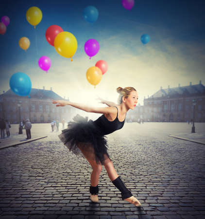 Girl dancing with colorful balloons in a square photo
