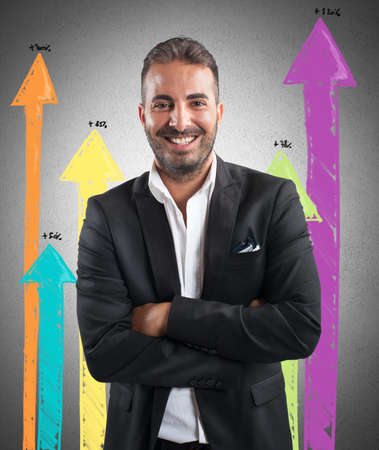 future earnings: Happy successful businessman with positive statistics trend