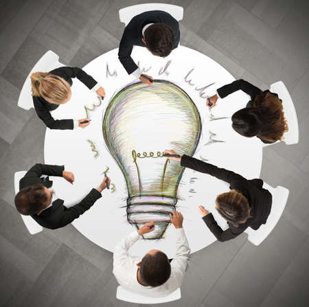 team strategy: Teamwork draws a big idea during a meeting Stock Photo