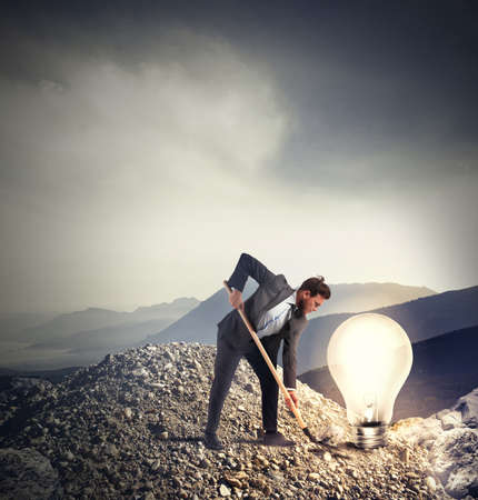 opportunity discovery: Businessman discovers an idea in a mountain