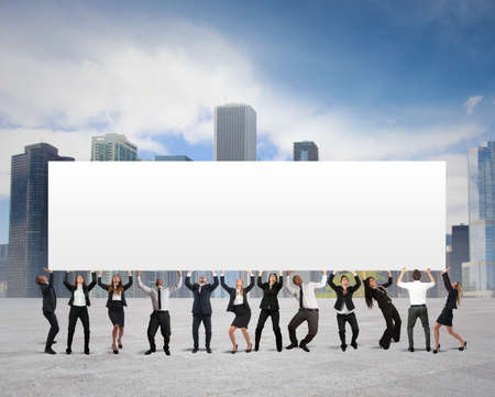 Business people holds a blank banner for your text photo