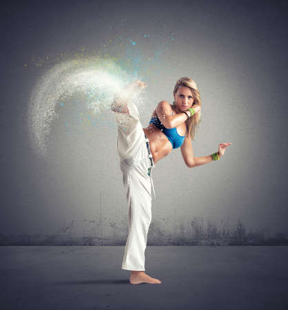Woman playing capoeira with motion effect photo