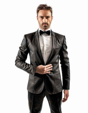 sexy man: Sexy elegant businessman with bow tie and white shirt