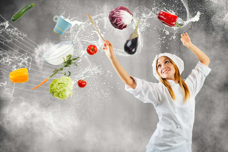 veges: Girl cooking as a master of symphonic orchestra Stock Photo