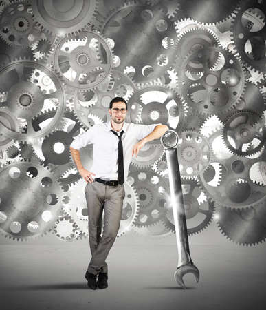 power wrench: Businessman makes maintenance of a system of gears Stock Photo