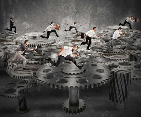 business competition: Business people running over a mechanism system