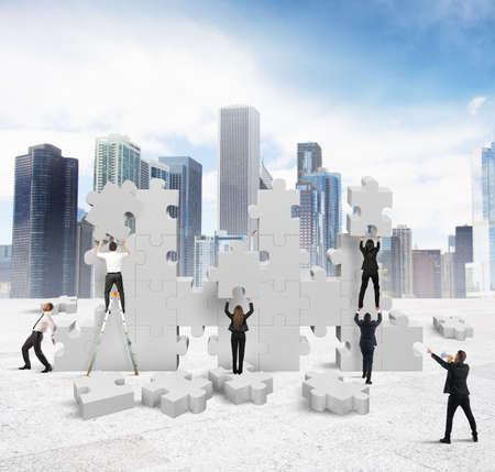 Business people builds  together a new company photo