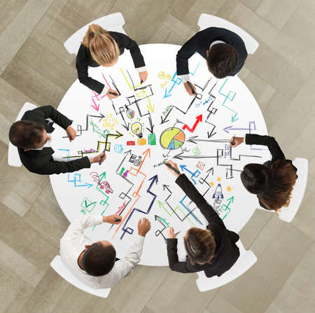 Teamwork of businesspeople that works on a new creative project