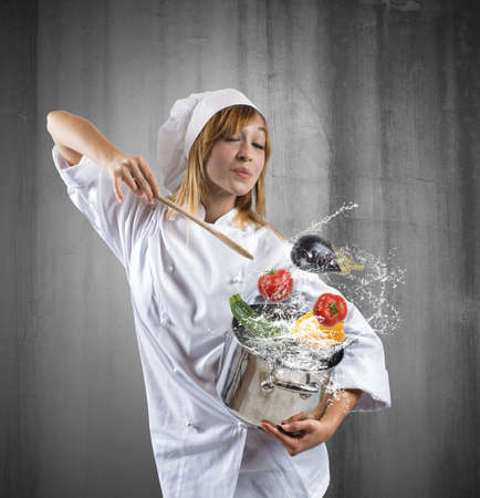 Tasty dish of a young girl chef photo