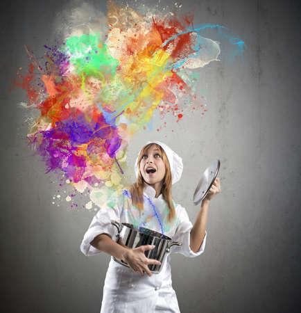 Chef bereitet eine Magie in der Küche Standard-Bild - 32370087