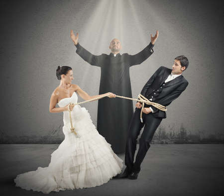 christian marriage: A man trapped with rope by marriage with the priest during the ceremony