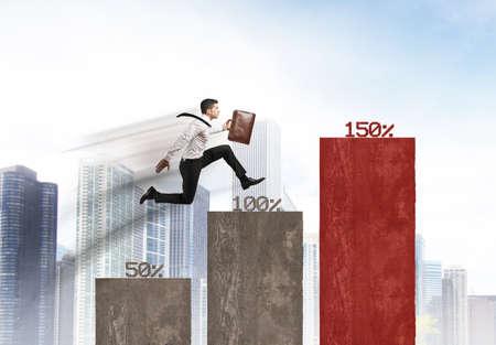ランナーのビジネスマンとのビジネスの成長の概念 写真素材