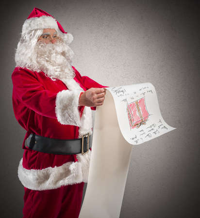 Santa Claus with a big gifts list photo